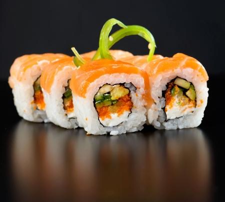 Sushi set isolated on black background Stock Photo