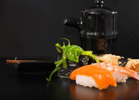 nigiri: Sushi and Rolls closeup over black background