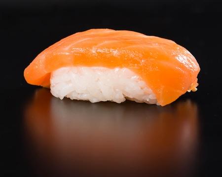 nigiri: sushi with chopsticks isolated on black Stock Photo