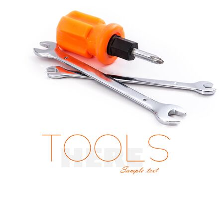 Wrenchs and screwdriver isolated on white photo