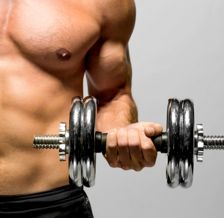 lift hands: Fitness - powerful muscular man lifting weights Stock Photo