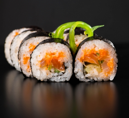 Maki sushi over black Stock Photo - 18568394