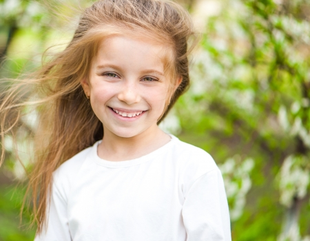 beautiful blonde girl with green eyes: adorable little girl on the meadow in solar day