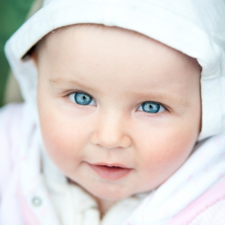 blue eyed: portrait of a cute baby girl close up Stock Photo