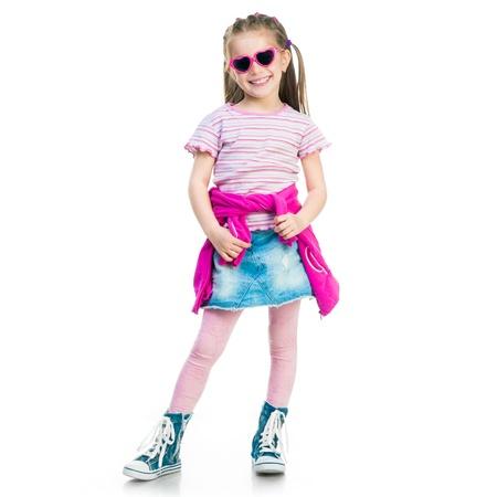 체육관 신발 및 흰색 배경에 치마에 아름 다운 작은 패션 소녀 스톡 콘텐츠