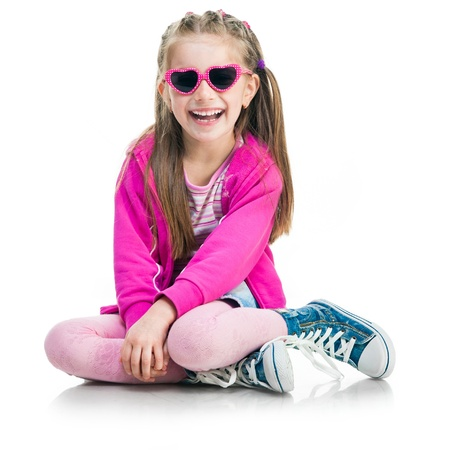 beautiful little fashion girl sit on a white background