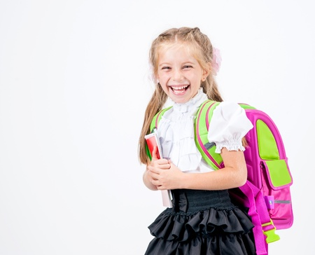 cute little girl in school uniform with backpack studio isolated photo