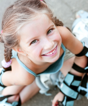 Little girl in roller skates at a park Stock Photo - 22450330