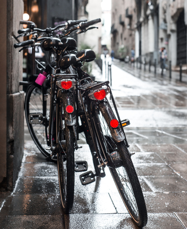 two bicycles in the rain in the Gothic Quarter of Barcelona, Spain photo