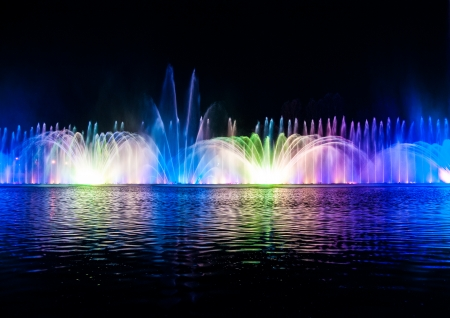 Musical fountain with colorful illuminations at night  Ukraine, Vinnitsa photo