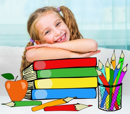 Portrait of little girl at workplace with the books photo