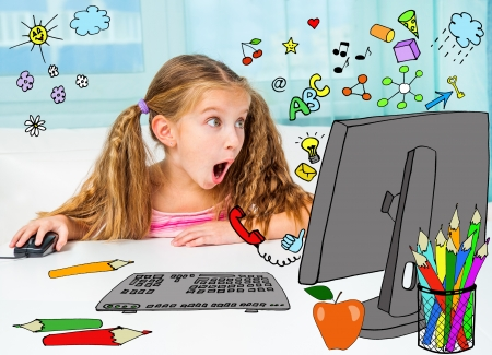 Surprised girl and her magic computer photo