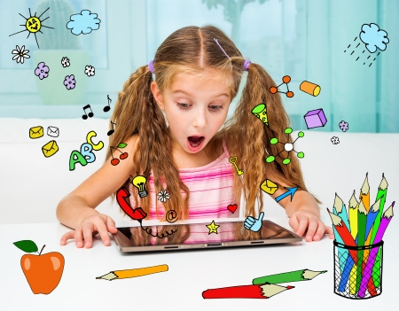 Surprised little girl and her magic tablet photo