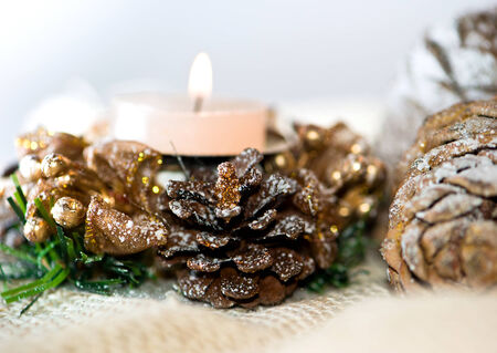 advent wreath with candle over white photo