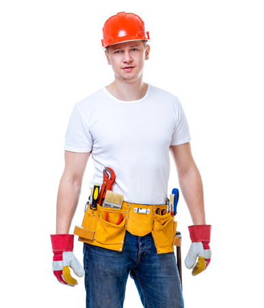 handsome worker man in a helmet on a white background isolated photo