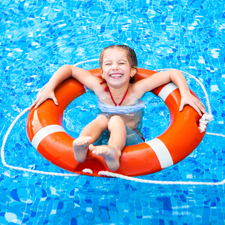 happy little girl in the pool floating on the Lifebuoy photo