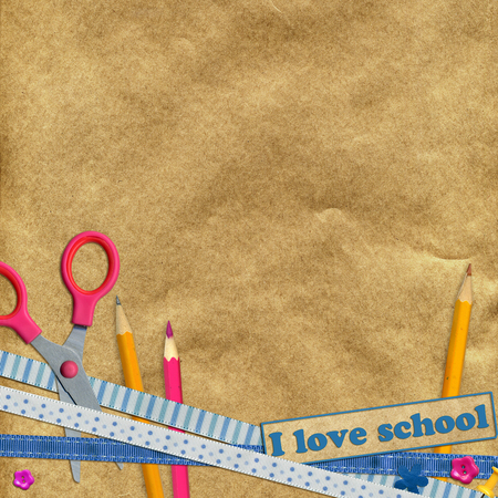 craft paper: education. scissors and pencils on the background of craft paper Stock Photo