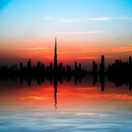 Dubai, United Arab Emirates  city and reflection in the rays of the setting sun photo