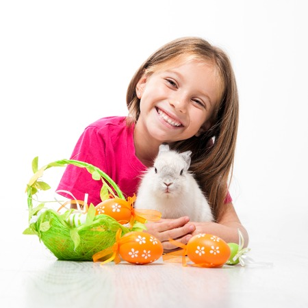 happy little girl with easter white bunny photo