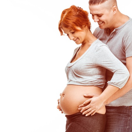 Young attractive couple  pregnant mother and happy father on white photo