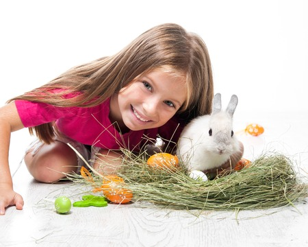Easter photo  happy little girl and rabbit photo