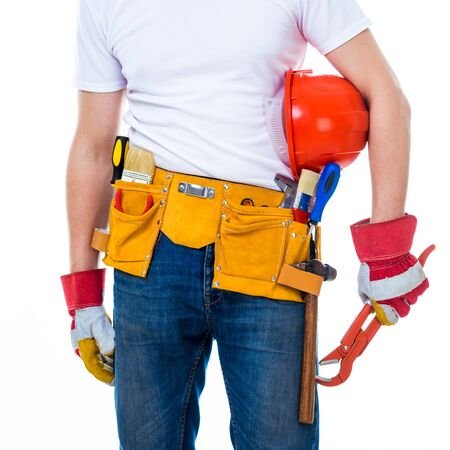 worker with tools belt holding an adjustable wrench photo