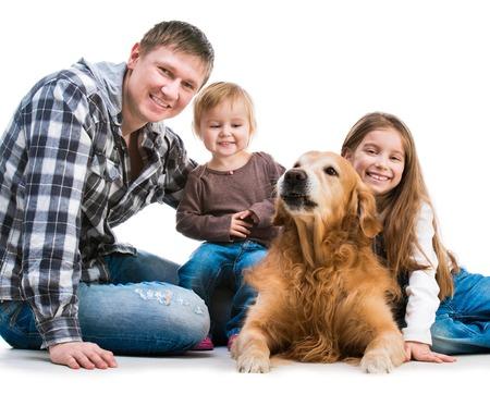 familiy: happy smiling familiy with a big dog isolated on white background Stock Photo