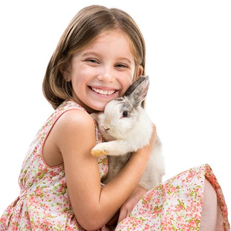 Easter photo  happy little girl with her rabbit close-up  Isolated on white background photo