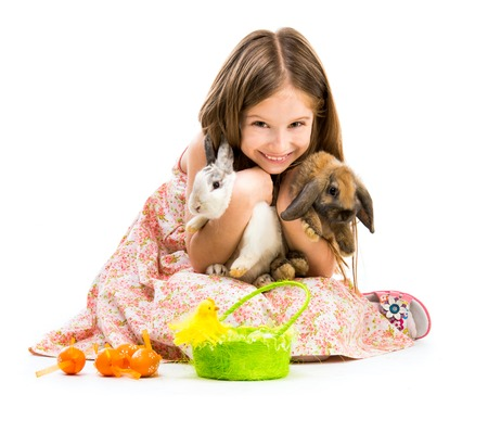 Easter photo  happy little girl with her two rabbits  Isolated on white background photo