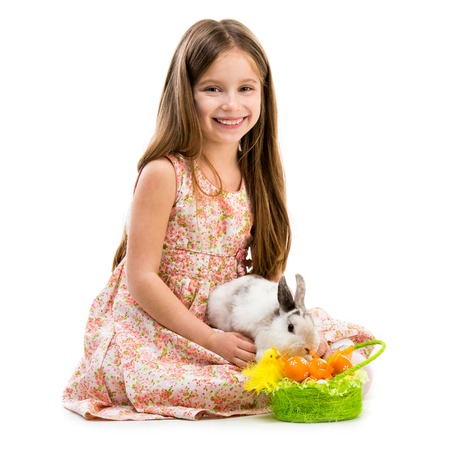 Easter photo  happy little girl with her rabbit  photo