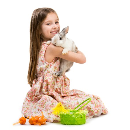 Happy little girl and rabbit  Isolated on white background photo