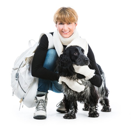 young woman with her dog cocker spaniel in a studio isolated on a white background photo