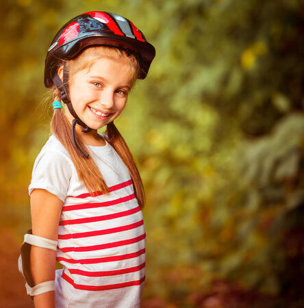 rollerskater: happy little girl on roller skates in the autumn forest close-up Stock Photo