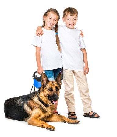 pre adolescents: happy children with a shepherd dog on a white background isolated Stock Photo