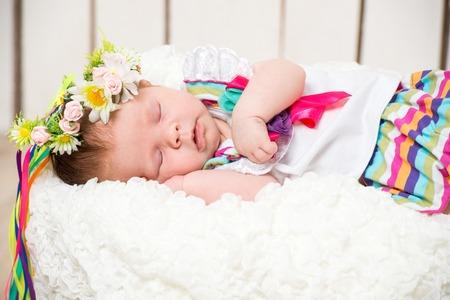 0 1 months: newborn girl sleeping in the Ukrainian national costume Stock Photo
