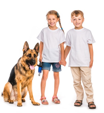 pre adolescents: happy kids in white t-shirts with shepherd dog isolated
