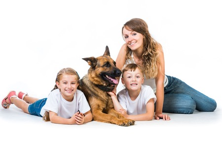 happy mother with two children and their shepherd photo