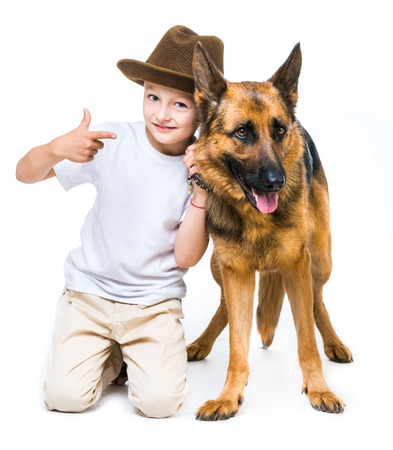 pre adolescent boy: happy little boy with his dog Stock Photo