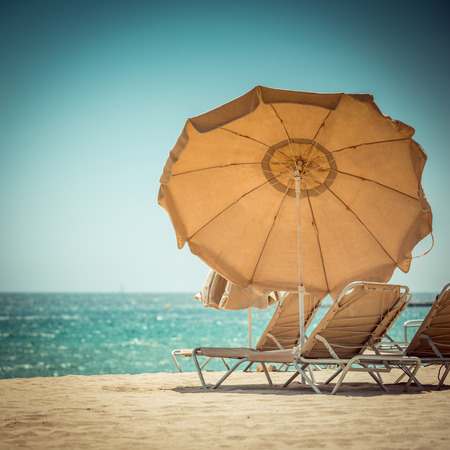 Sunbed and umbrella on Tropical beach photo