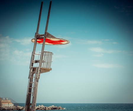 An empty lifeguard tower overlooking the ocean at the beach. photo