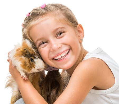 happy girl with a cavy. studio shot on white background photo