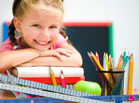 cute happy little girl on education background Standard-Bild