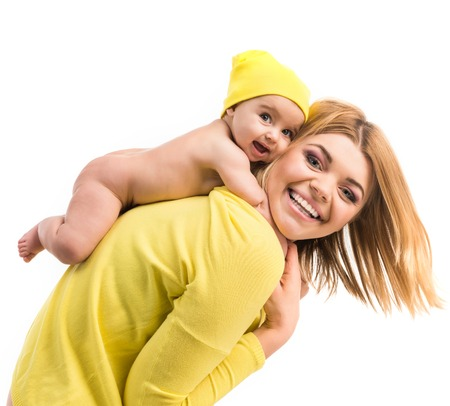 0 6 months: young mother with her little daughter. Isolated on white background
