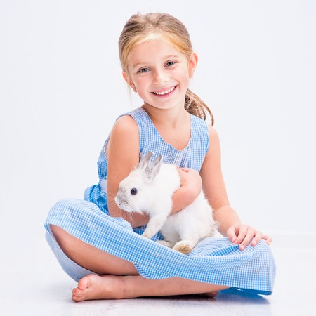 6 7 years: happy little girl with her rabbit