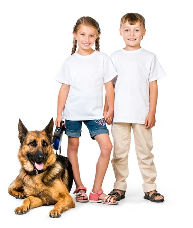 pre adolescents: happy children with a shepherd dog Stock Photo