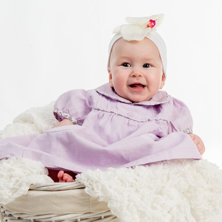 babycare: Adorable five month baby girl in wicker basket