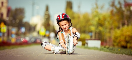rollerblade: happy little girl on roller skates in the autumn forest