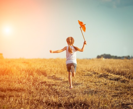 cute: happy cute little girl with a windmill