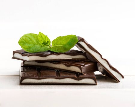 chocolate mint: mint chocolate with mint leaves on a wooden background