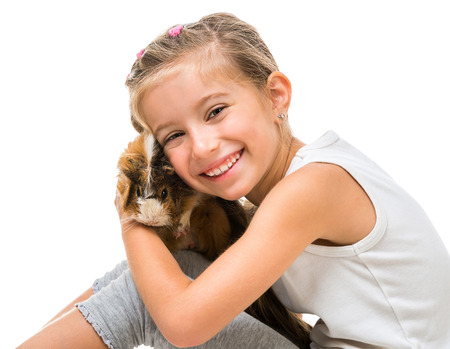 6 7 years: cute girl with a cavy. isolated on white background